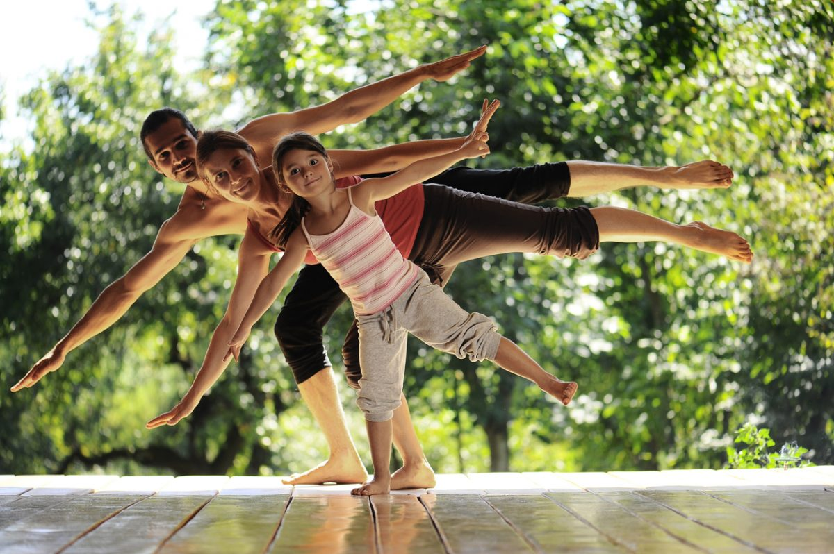 Young Family Practicing Yoga